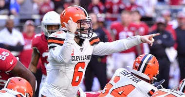 Cleveland Browns quarterback Baker Mayfield (6) signals to teammates during the first half against the Arizona Cardinals at State Farm Stadium.