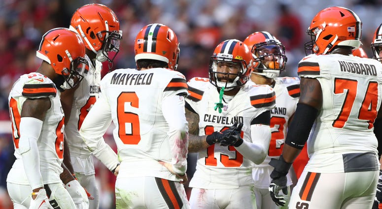 Cleveland Browns wide receiver Odell Beckham Jr. (13) in the huddle with quarterback Baker Mayfield (6) against the Arizona Cardinals at State Farm Stadium.