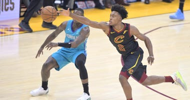 Dec 18, 2019; Cleveland, OH, USA; Cleveland Cavaliers guard Collin Sexton (2) steals the ball against Charlotte Hornets guard Terry Rozier (3) in the second quarter at Rocket Mortgage FieldHouse. Mandatory Credit: David Richard-USA TODAY Sports