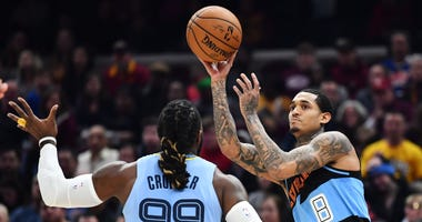 Dec 20, 2019; Cleveland, OH, USA; Cleveland Cavaliers guard Jordan Clarkson (8) looks to pass against the defense of Memphis Grizzlies forward Jae Crowder (99) during the first half at Rocket Mortgage FieldHouse. Mandatory Credit: Ken Blaze-USA TODAY Spor