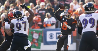 Cleveland Browns quarterback Baker Mayfield (6) throws the ball against the Baltimore Ravens during the first quarter at FirstEnergy Stadium.