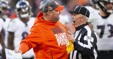 Cleveland Browns head coach Freddie Kitchens talks with head linesman Jeff Bergman (32) during the fourth quarter against the Baltimore Ravens at FirstEnergy Stadium.