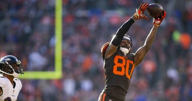 Cleveland Browns wide receiver Jarvis Landry (80) leaps for the ball past Baltimore Ravens cornerback Marcus Peters (24) during the second quarter at FirstEnergy Stadium.