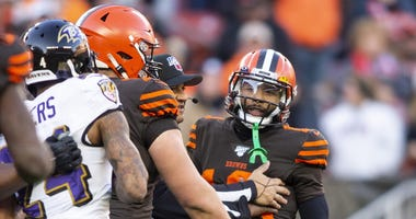 Cleveland Browns wide receiver Odell Beckham (13) is held back as he exchanges words with Baltimore Ravens cornerback Marcus Peters (24) during the fourth quarter at FirstEnergy Stadium.