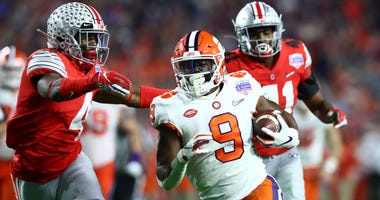 Dec 28, 2019; Glendale, AZ, USA; Clemson Tigers running back Travis Etienne (9) scores a touchdown against the Ohio State Buckeyes during the fourth quarter in the 2019 Fiesta Bowl college football playoff semifinal game at State Farm Stadium. Mandatory C