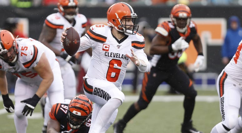 Baker Mayfield (6) runs with the ball against the Cincinnati Bengals during the first half at Paul Brown Stadium. Mandatory Credit: David Kohl-USA TODAY Sports