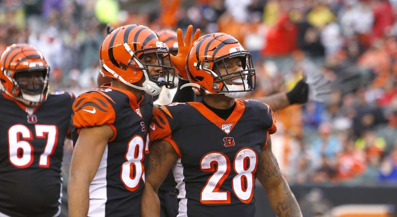 Dec 29, 2019; Cincinnati, Ohio, USA; Cincinnati Bengals running back Joe Mixon (28) reacts with wide receiver Tyler Boyd (83) after scoring touchdown against the Cleveland Browns during the second half at Paul Brown Stadium. Mandatory Credit: David Kohl-U