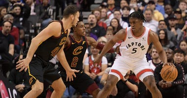 Dec 31, 2019; Toronto, Ontario, CAN; Toronto Raptors forward Stanley Johnson (5) controls the ball as Cleveland Cavaliers guard Collin Sexton (2) and center Ante Zizic (41) defend