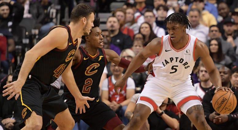 Dec 31, 2019; Toronto, Ontario, CAN; Toronto Raptors forward Stanley Johnson (5) controls the ball as Cleveland Cavaliers guard Collin Sexton (2) and center Ante Zizic (41) defend
