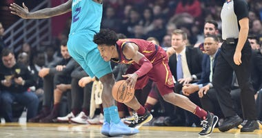 Jan 2, 2020; Cleveland, Ohio, USA; Cleveland Cavaliers guard Collin Sexton (2) drives the ball against Charlotte Hornets forward Marvin Williams (2) during the first half at Rocket Mortgage FieldHouse. Mandatory Credit: Ken Blaze-USA TODAY Sports