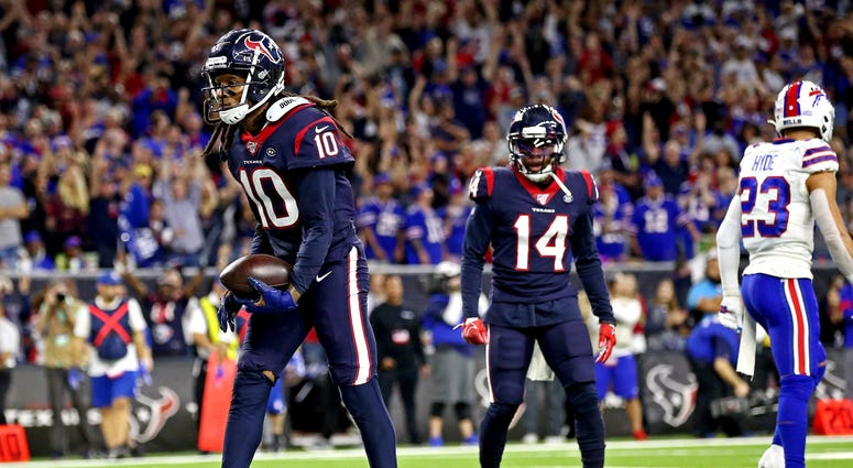 Jan 4, 2020; Houston, Texas, USA; Houston Texans wide receiver DeAndre Hopkins (10) celebrates after scoring a two point conversion during the fourth quarter against the Buffalo Bills in the AFC Wild Card NFL Playoff game at NRG Stadium. Mandatory Credit: