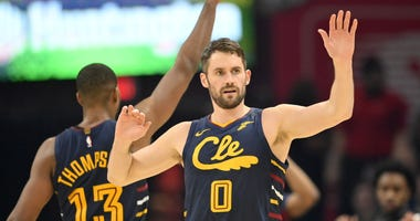 Jan 7, 2020; Cleveland, Ohio, USA; Cleveland Cavaliers center Tristan Thompson (13) and forward Kevin Love (0) react in the second quarter against the Detroit Pistons at Rocket Mortgage FieldHouse. Mandatory Credit: David Richard-USA TODAY Sports