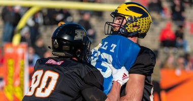 North tight end Brycen Hopkins of Purdue (89) spars with tight end Sean McKeon of Michigan (86) during Senior Bowl practice at Ladd-Peebles Stadium.