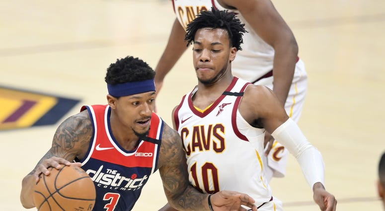 Jan 23, 2020; Cleveland, Ohio, USA; Washington Wizards guard Bradley Beal (3) drives against Cleveland Cavaliers guard Darius Garland (10) in the first quarter at Rocket Mortgage FieldHouse. Mandatory Credit: David Richard-USA TODAY Sports
