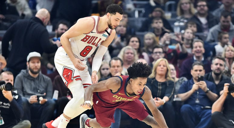 Jan 25, 2020; Cleveland, Ohio, USA; Cleveland Cavaliers guard Collin Sexton (2) pursues a loose ball against Chicago Bulls guard Zach LaVine (8) during the first half at Rocket Mortgage FieldHouse. Mandatory Credit: Ken Blaze-USA TODAY Sports