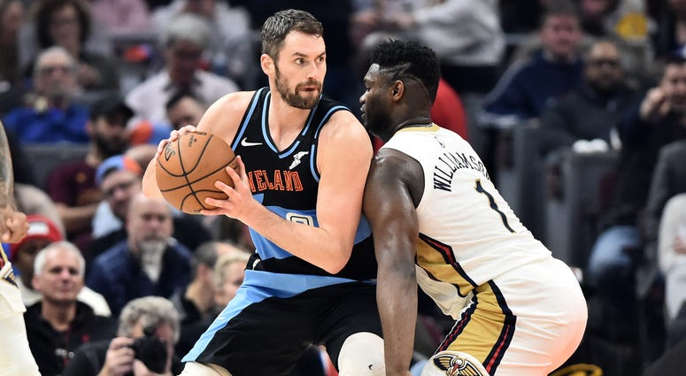 Jan 28, 2020; Cleveland, Ohio, USA; New Orleans Pelicans forward Zion Williamson (1) guards Cleveland Cavaliers forward Kevin Love (0) during the first half at Rocket Mortgage FieldHouse. Mandatory Credit: Ken Blaze-USA TODAY Sports