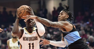 Jan 28, 2020; Cleveland, Ohio, USA; New Orleans Pelicans guard Jrue Holiday (11) drives to the basket against Cleveland Cavaliers guard Kevin Porter Jr. (4) during the first half at Rocket Mortgage FieldHouse. Mandatory Credit: Ken Blaze-USA TODAY Sports
