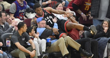 Toronto Raptors guard Kyle Lowry (7) falls in to the stands in the fourth quarter against the Cleveland Cavaliers at Rocket Mortgage FieldHouse. David Richard-USA TODAY Sports