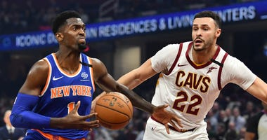 Feb 3, 2020; Cleveland, Ohio, USA; New York Knicks forward Bobby Portis (1) drives to the basket against Cleveland Cavaliers forward Larry Nance Jr. (22) during the first half at Rocket Mortgage FieldHouse. Mandatory Credit: Ken Blaze-USA TODAY Sports