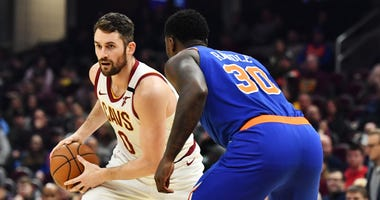 Feb 3, 2020; Cleveland, Ohio, USA; Cleveland Cavaliers forward Kevin Love (0) controls the ball against New York Knicks forward Julius Randle (30) during the second half at Rocket Mortgage FieldHouse. Mandatory Credit: Ken Blaze-USA TODAY Sports