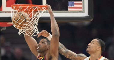 Feb 12, 2020; Cleveland, Ohio, USA; Cleveland Cavaliers center Tristan Thompson (13) dunks beside Atlanta Hawks forward John Collins (20) in the second quarter at Rocket Mortgage FieldHouse. Mandatory Credit: David Richard-USA TODAY Sports