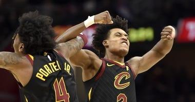 Feb 12, 2020; Cleveland, Ohio, USA; Cleveland Cavaliers guard Kevin Porter Jr. (4) and guard Collin Sexton (2) celebrate in the third quarter against the Atlanta Hawks at Rocket Mortgage FieldHouse. Mandatory Credit: David Richard-USA TODAY Sports