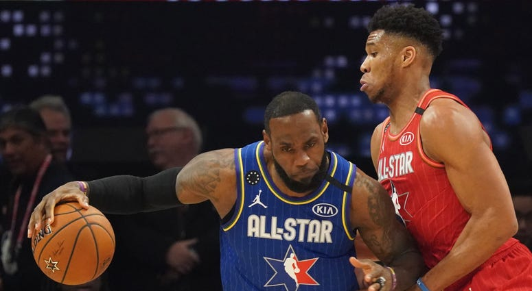 Los Angeles Lakers player LeBron James (left) and Milwaukee Bucks player Giannis Antetokounmpo