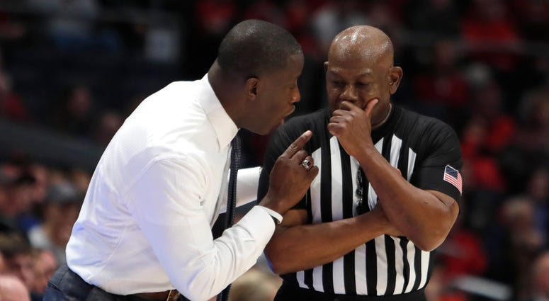 Feb 22, 2020; Dayton, Ohio, USA; Dayton Flyers head coach Anthony Grant (left) talks to a referee during the second half against the Duquesne Dukes at University of Dayton Arena. Mandatory Credit: David Kohl-USA TODAY Sports