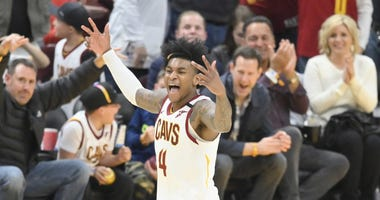 Cleveland Cavaliers guard Kevin Porter Jr. (4) celebrates his three-point basket in the fourth quarter against the Miami Heat at Rocket Mortgage FieldHouse.