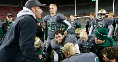 Athens head football coach Ryan Adams talks to his team following a 56-52 loss to Toledo Central Catholic in Thursday night's OHSAA Division III championship football game at Ohio Stadium in Columbus on Dec. 4, 2014.