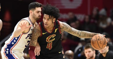 Feb 26, 2020; Cleveland, Ohio, USA; Philadelphia 76ers guard Furkan Korkmaz (30) defends Cleveland Cavaliers guard Kevin Porter Jr. (4) during the first half at Rocket Mortgage FieldHouse. Mandatory Credit: Ken Blaze-USA TODAY Sports
