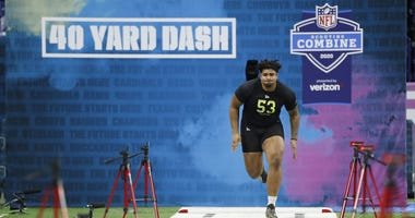 Feb 28, 2020; Indianapolis, Indiana, USA; Iowa Hawkeyes offensive lineman Tristan Wirfs (OL53) runs the 40 yard dash during the 2020 NFL Combine at Lucas Oil Stadium. Mandatory Credit: Brian Spurlock-USA TODAY Sports