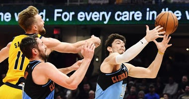 Feb 29, 2020; Cleveland, Ohio, USA; Indiana Pacers forward Domantas Sabonis (11) and Cleveland Cavaliers forward Kevin Love (0) and forward Cedi Osman (16) go for a rebound during the first half at Rocket Mortgage FieldHouse. Mandatory Credit: Ken Blaze-U