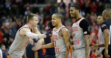 Mar 5, 2020; Columbus, Ohio, USA; Ohio State Buckeyes guard CJ Walker (center) celebrates with guard Luther Muhammad (right) and forward Justin Ahrens (left)as time winds down during the second half against the Illinois Fighting Illini at Value City Arena