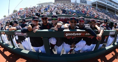 Cleveland Indians players pose for a photo prior to a spring training game against the Chicago Cubs at Goodyear Ballpark.