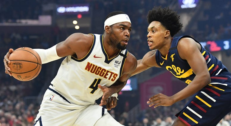 Mar 7, 2020; Cleveland, Ohio, USA; Denver Nuggets forward Paul Millsap (4) drives to the basket against Cleveland Cavaliers guard Collin Sexton (2) during the first half at Rocket Mortgage FieldHouse. Mandatory Credit: Ken Blaze-USA TODAY Sports