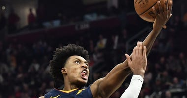 Cleveland Cavaliers guard Collin Sexton (2) drives to the basket against Denver Nuggets guard Gary Harris (14) during the second half at Rocket Mortgage FieldHouse.