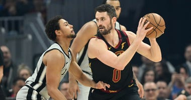 Mar 8, 2020; Cleveland, Ohio, USA; Cleveland Cavaliers forward Kevin Love (0) holds the ball as San Antonio Spurs guard Bryn Forbes (11) defends during the first half at Rocket Mortgage FieldHouse. Mandatory Credit: Ken Blaze-USA TODAY Sports