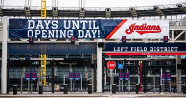Mar 14, 2020; Cleveland, Ohio, USA; The sign on Progressive Field, home of the Cleveland Indians, has been changed to show that Major League Baseball s opening day is now on hold. The Mid-American Conference basketball tournament, which was to be held nex