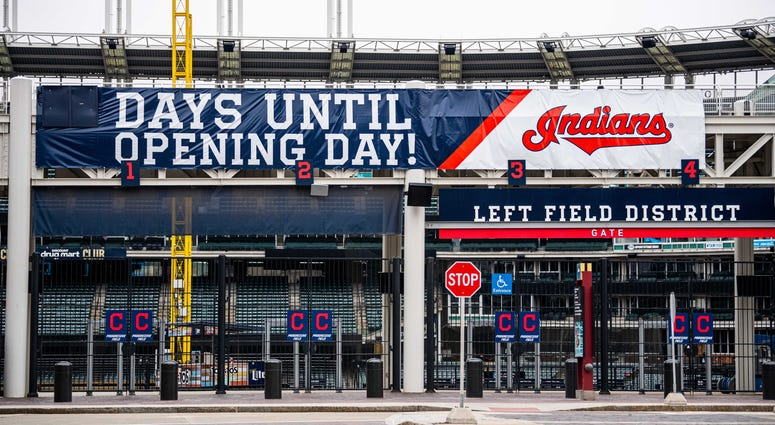 The sign on Progressive Field, home of the Cleveland Indians, has been changed to show that Major League Baseball s opening day is now on hold. The Mid-American Conference basketball tournament, which was to be held next door at Rocket Mortgage FieldHouse