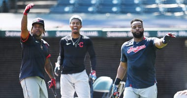 Jul 6, 2020; Cleveland, Ohio, United States; Cleveland Indians third baseman Jose Ramirez (left) shortstop Francisco Lindor (middle) and first baseman Carlos Santana motion to the dugout during workouts at Progressive Field. Mandatory Credit: Ken Blaze-US