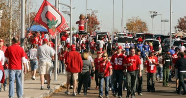 Ohio State fans pack the parking lot prior to the gates opening for the BCS National Championship game at the University of Phoenix Stadium.
