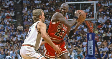Chicago Bulls guard Michael Jordan is defended by Cleveland Cavaliers guard Craig Ehlo