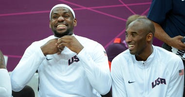 Aug 2, 2012; London, United Kingdom; United States players LeBron James (left) and Kobe Bryant react during the preliminary game against Nigeria in the London 2012 Olympic Games at Basketball Arena. The United States defeated Nigeria 156-73. Mandatory Cre
