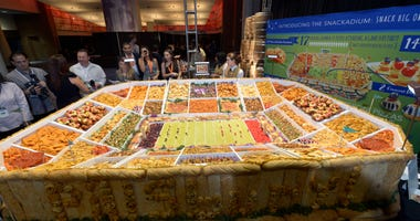 The Pillsbury company's Snackadium showcasing creative snacks for the big game draws partygoers to snack out of the edible stadium during the Taste of the NFL at the New Orleans Convention Center prior to the Super Bowl XLVII. The Taste of the NFL is a n