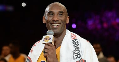 Apr 13, 2016; Los Angeles, CA, USA; Los Angeles Lakers forward Kobe Bryant (24) smiles as he addresses the crowd after the Lakers defeat of the Utah Jazz in the final game of his career at Staples Center. Mandatory Credit: Robert Hanashiro-USA TODAY Sport