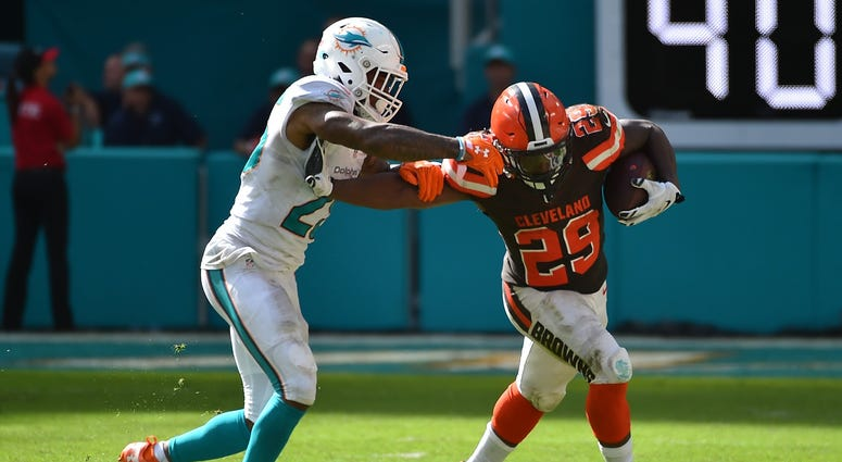 Sep 25, 2016; Miami Gardens, FL, USA; Cleveland Browns running back Duke Johnson (29) stiff arms Miami Dolphins cornerback Xavien Howard (25) during the second half at Hard Rock Stadium.The Miami Dolphins defeat the Cleveland Browns 34-20 in overtime. Man