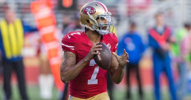 San Francisco 49ers quarterback Colin Kaepernick (7) looks down field during the second quarter against the Seattle Seahawks at Levis Stadium