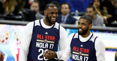 Feb 18, 2017; New Orleans, LA, USA; Eastern Conference forward LeBron James of the Cleveland Cavaliers (23) and Eastern Conference forward Kyrie Irving of the Cleveland Cavaliers (2) laugh during the NBA All-Star Practice at the Mercedes-Benz Superdome. M