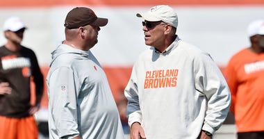 Cleveland Browns head coach Freddie Kitchens (left) talks with general manager John Dorsey